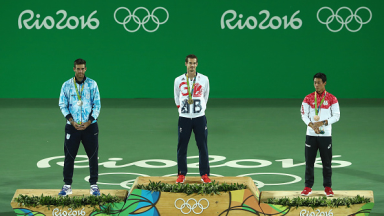 RIO DE JANEIRO, BRAZIL - AUGUST 14:  (L-R) Silver medalist Juan Martin Del Potro of Argentina, gold medalist Andy Murray of Great Britain and bronze medalist Kei Nishikori of Japan pose during the medal ceremony for the men's singles on Day 9 of the Rio 2016 Olympic Games at the Olympic Tennis Centre on August 14, 2016 in Rio de Janeiro, Brazil.  (Photo by Julian Finney/Getty Images)