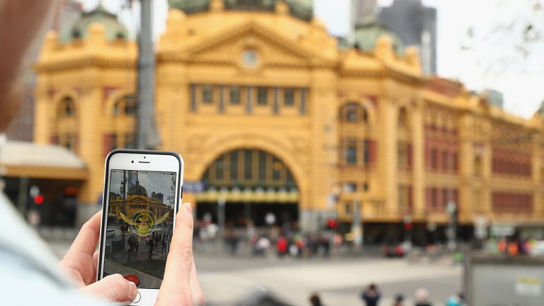 MELBOURNE, AUSTRALIA - JULY 13:  Tristan plays the Pokemon Go game on his phone in front of Flinders Stret Station on July 13, 2016 in Melbourne, Australia. The augmented reality app requires players to look for Pokemon in their immediate surroundings with the use of GPS and internet services turning the whole world into a Pokemon region map. The hugely popular app has seen Nintendo shares soar following its limited release in the US, Australia and New Zealand on July 6.  (Photo by Robert Cianflone/Getty Images)
