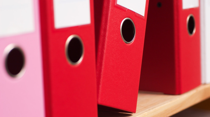 Folders on shelf --- Image by © Royalty-Free/Corbis