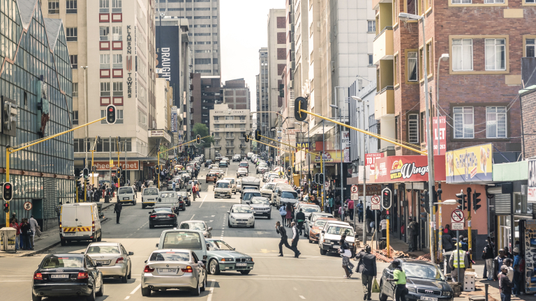 JOHANNESBURG, SOUTH AFRICA - NOVEMBER 13, 2014: rush hour and traffic jam on Von Wiellig Street at the crossroad with Comminsioner St in the crowded and modern multiracial capital of South Africa.