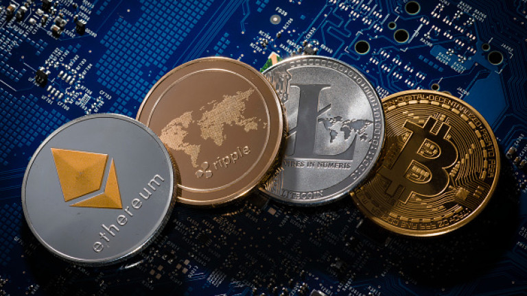 BERLIN, GERMANY - JANUARY 25:  In this photo illustration model coins of the cryptocurrencies ethereum, ripple, litecoin and bitcoin lie on a circuit board of a computer on January 25, 2018 in Berlin, Germany. (Photo Illustration by Thomas Trutschel/Photothek via Getty Images)